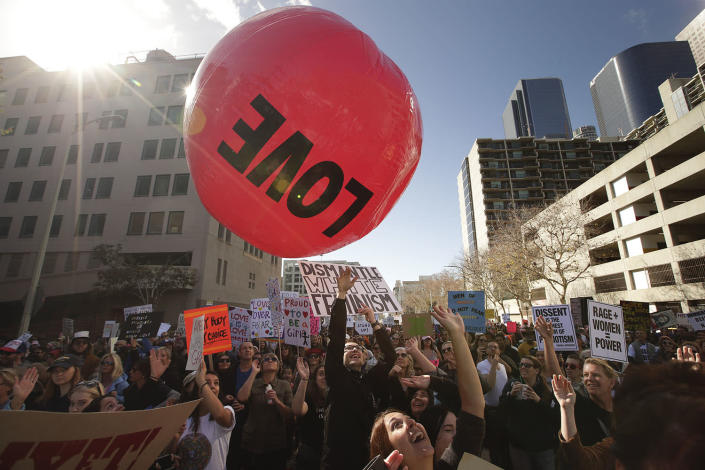 <p>A group of protesters toss the inflated ball around while marching along the street at the Women's Protest against President Donald Trump Saturday, Jan. 21, 2017, in Los Angeles. (AP Photo/Jae C. Hong) </p>