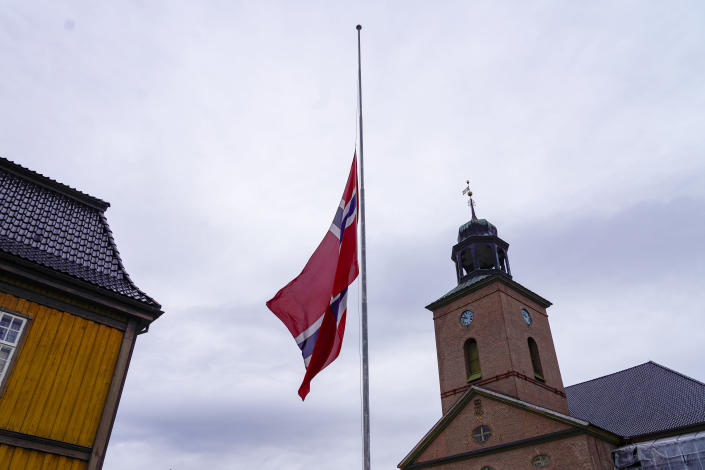 The Norwegian flag is at half-mast in Kongsberg the day after a man killed several people, in Kongsberg, Norway, Thursday, Oct. 14, 2021. Police in Norway are holding a 37-year-old man from Denmark suspected in a bow-and-arrow attack in a small town that killed five people and wounded two others. (Terje Bendiksby/NTB via AP)