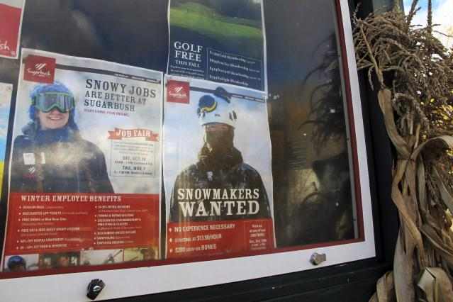 In this Oct. 23, 2019, photo, a posters advertising ski season jobs and a job fair are displayed on a bulletin board a at Sugarbush Resort in Warren, Vt. In the tight labor market, ski areas are having a tough time hiring seasonal workers so they're upping the ante by boosting wages, offering more worker housing and other incentives. (AP Photo/Lisa Rathke)