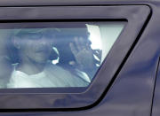 President Barack Obama waves from the window of his motorcade vehicle as he returns from golf and a walk on the beach with his family at Marine Corp Base Hawaii, in Kailua, Hawaii, Wednesday, Dec. 26, 2012. The president and the first family are in Hawaii for a family holiday vacation. (AP Photo/Gerald Herbert)