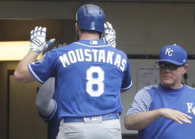 Kansas City Royals' Mike Moustakas is congratulated after hitting a home run during the seventh inning of a baseball game against the Milwaukee Brewers Wednesday, June 27, 2018, in Milwaukee. (AP Photo/Morry Gash)