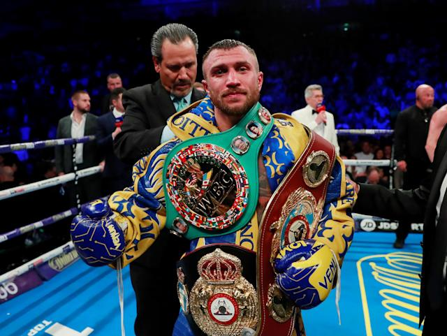 Vasyl Lomachenko poses on Saturday as he celebrates winning his lightweight title fight vs. Luke Campbell in London. (Reuters/Andrew Couldridge)