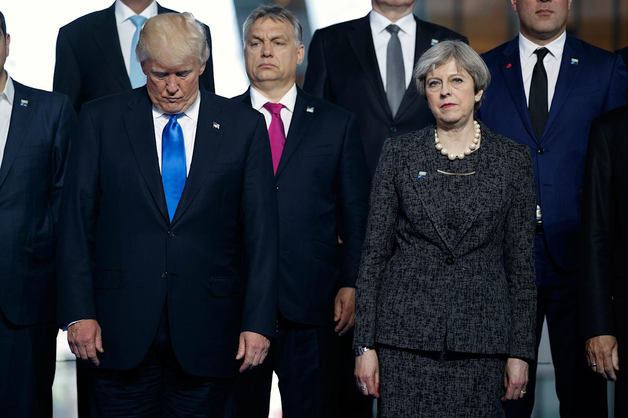 <p>President Donald Trump stands with British Prime Minister Theresa May during a group photo with NATO leaders at the new NATO headquarters, Thursday, May 25, 2017, in Brussels. (AP Photo/Evan Vucci) </p>