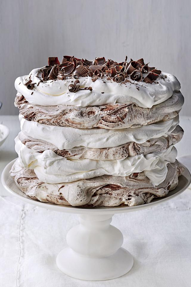 """<p><b>Recipe: <a href=""""https://www.southernliving.com/recipes/chocolate-coconut-pavlova-cake"""">Chocolate-Coconut Pavlova Cake</a></b></p> <p>This dairy-free and gluten-free dessert will be the most beautiful star of your holiday dinner.</p>"""