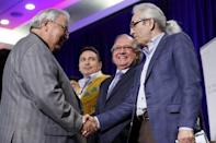 Justice Murray Sinclair (L) greets former Assembly of First Nations National Chief Phil Fontaine with Minister of Aboriginal Affairs and Northern Developement Bernard Valcourt (C) at a Truth and Reconciliation Commission of Canada event in Ottawa June 2, 2015. REUTERS/Blair Gable