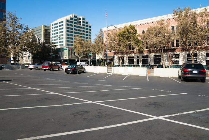 """<span class=""""caption"""">Surface parking in downtown San Jose, California.</span> <span class=""""attribution""""><a class=""""link rapid-noclick-resp"""" href=""""https://flic.kr/p/gEZrb2"""" rel=""""nofollow noopener"""" target=""""_blank"""" data-ylk=""""slk:Sergio Ruiz, SPUR/Flickr"""">Sergio Ruiz, SPUR/Flickr</a>, <a class=""""link rapid-noclick-resp"""" href=""""http://creativecommons.org/licenses/by/4.0/"""" rel=""""nofollow noopener"""" target=""""_blank"""" data-ylk=""""slk:CC BY"""">CC BY</a></span>"""
