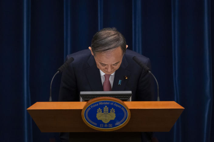 Japanese Prime Minister Yoshihide Suga bows during a press conference at the prime minister's official residence on Friday, May 14, 2021, in Tokyo. Suga announced that the current coronavirus state of emergency covering Tokyo, Osaka and a number of other areas, will be extended to the prefectures of Hokkaido, Okayama and Hiroshima from Sunday as Japan battles a fourth wave of coronavirus. (Yuichi Yamazaki/Pool Photo via AP)