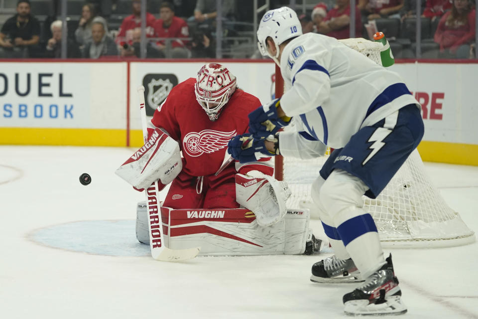Detroit Red Wings goaltender Alex Nedeljkovic (39) stops a Tampa Bay Lightning right wing Corey Perry (10) shot in the first period of an NHL hockey game Thursday, Oct. 14, 2021, in Detroit. (AP Photo/Paul Sancya)