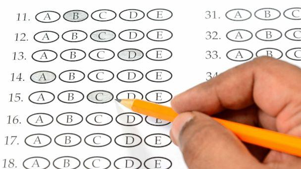 PHOTO: A student appears to be filling out a multiple choice exam paper with a pencil. (STOCK PHOTO/Getty Images)