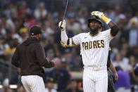San Diego Padres' Jurickson Profar reacts after being called out on strikes with the bases loaded, ending the sixth inning against the Colorado Rockies in a baseball game Saturday, July 31, 2021, in San Diego. (AP Photo/Derrick Tuskan)