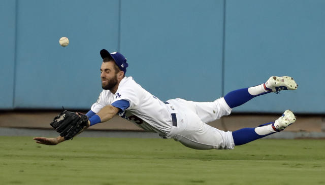 <p>Los Angeles Dodgers center fielder Chris Taylor can't get a glove on a RBI-single by Houston Astros' Alex Bregman during the third inning of Game 2 of baseball's World Series Wednesday, Oct. 25, 2017, in Los Angeles. (AP Photo/Matt Slocum) </p>