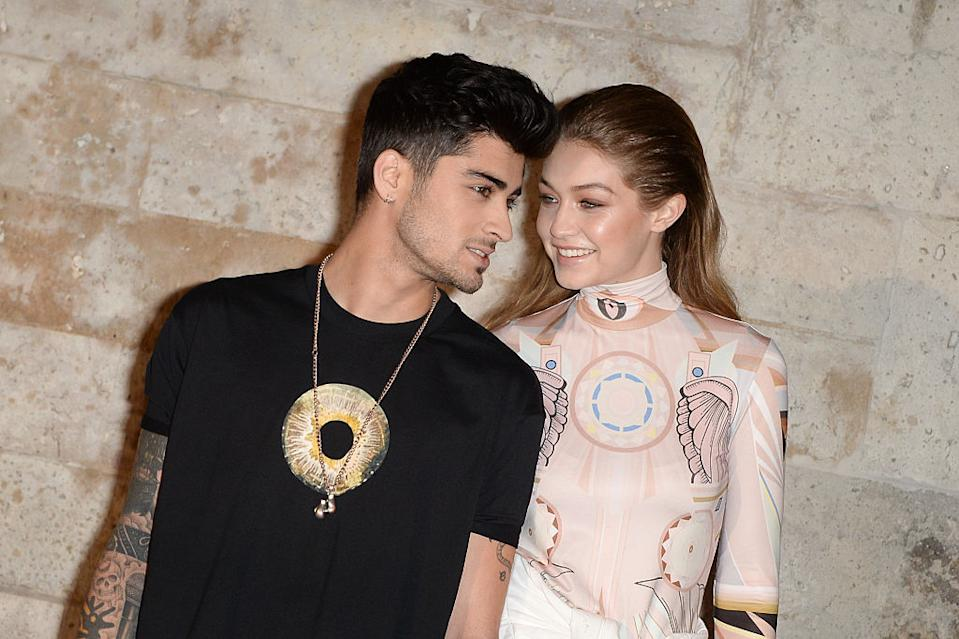 Gigi Hadid and Zayn Malik are reportedly expecting their first baby, pictured here at Paris Fashion Week in October, 2016 (Getty Images)