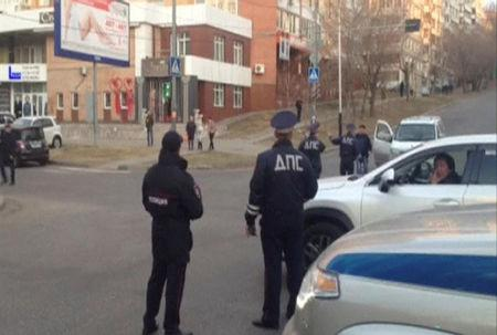 Interior Ministry officers block a street near a regional office of Federal Security Service which was attacked by a gunman in Khabarovsk