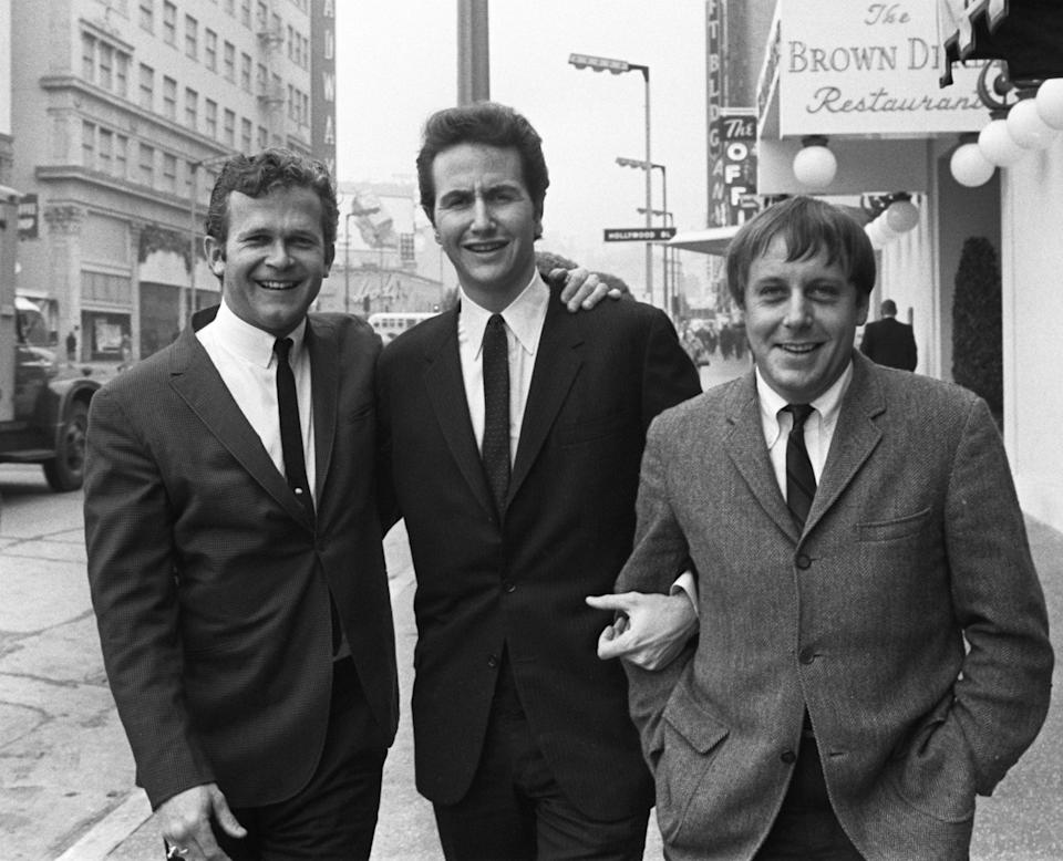 Bob Shane, left, poses with fellow Kingston Trio members John Stewart and Nick Reynolds in Los Angeles in 1967. Stewart joined the group after the departure of original member Dave Guard. Shane died Sunday at 85.