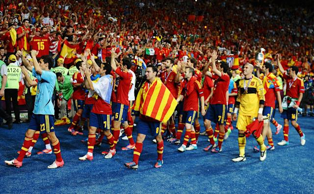 KIEV, UKRAINE - JULY 01: Spain players celebrate victory after the UEFA EURO 2012 final match between Spain and Italy at the Olympic Stadium on July 1, 2012 in Kiev, Ukraine. (Photo by Laurence Griffiths/Getty Images)