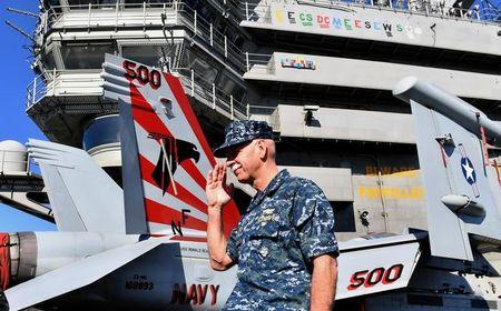 Commander of the US Pacific Fleet Admiral Scott Swift participates in a closing ceremony for the military exercise called Talisman Saber aboard the USS Ronald Reagan in Brisbane, Australia