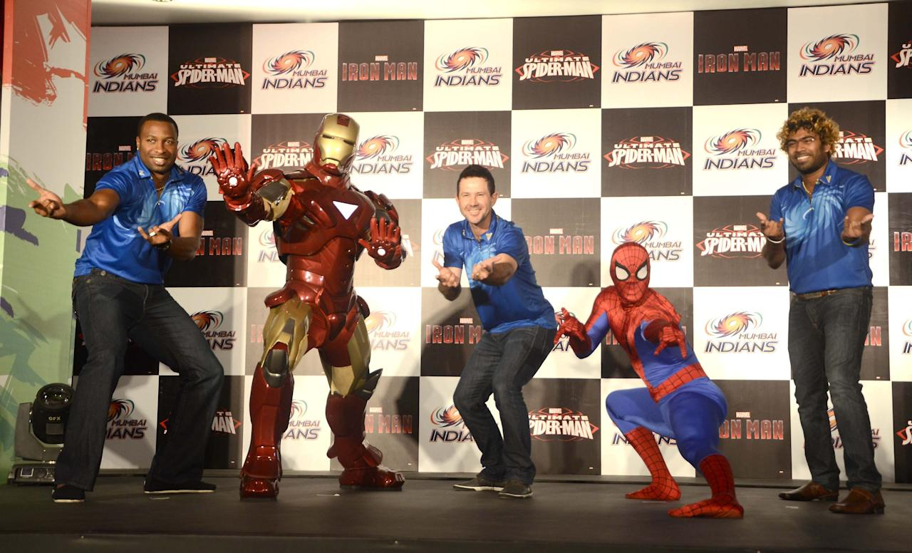 Marvel Super Heroes, Ironmanand Spiderman make a special apperance for Mumbai Indians teammates Ricky Ponting, Lasith Malinga and Kieron Pollard at the unveil of a special  merchandise in Mumbai on April 7 2013. (Photo:IANS)