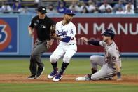 Houston Astros' Kyle Tucker, right, slides into second base with a double next to Los Angeles Dodgers second baseman Mookie Betts during the second inning of a baseball game Tuesday, Aug. 3, 2021, in Los Angeles. (AP Photo/Marcio Jose Sanchez)
