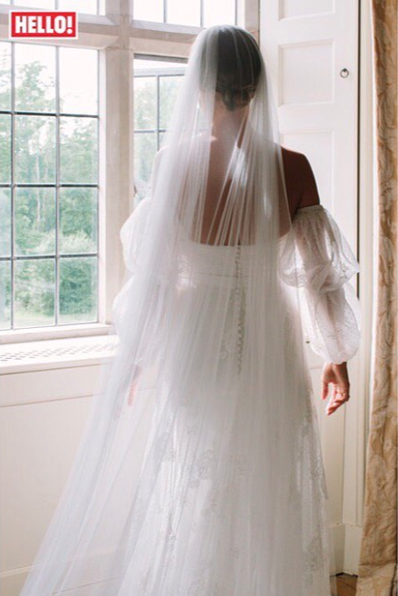 <p>The former 'Made In Chelsea' star wore a bespoke Halfpenny London dress for her wedding to Hugo Taylor. Made from French lace, spotty tulle and silk organza, the gown boasted double bubble sleeves and a long, plain veil. [Photo: Instagram via Hello! magazine] </p>