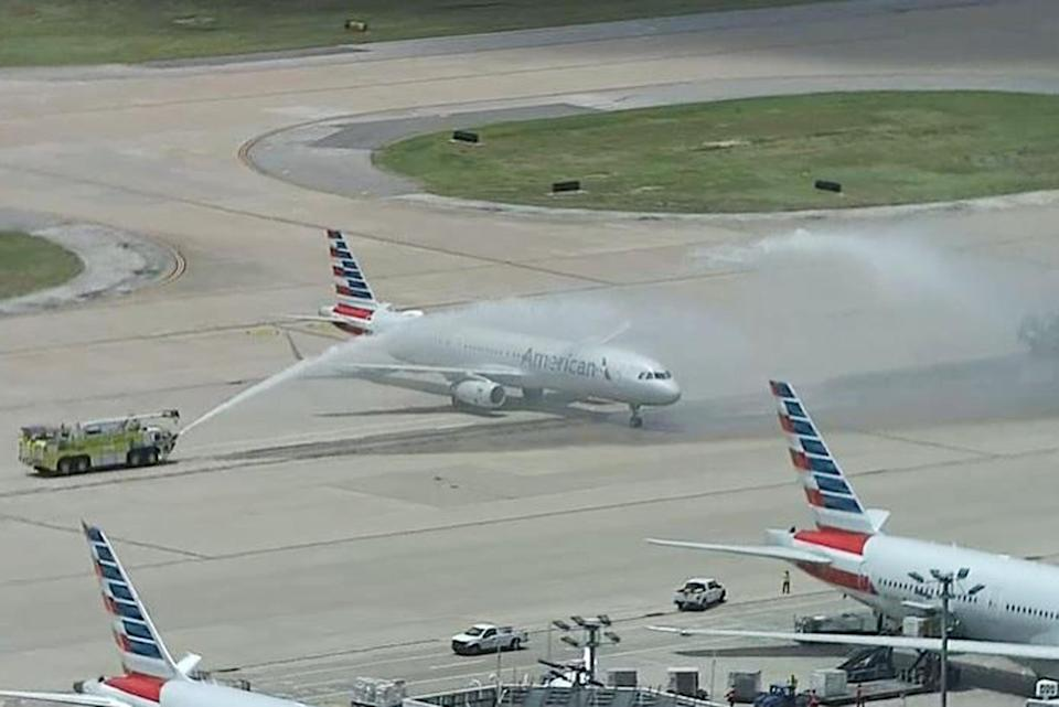 A plane carrying Elijah Snow's remains is saluted by firetrucks at Dallas-Fort Worth International Airport. (NBC5 DFW)