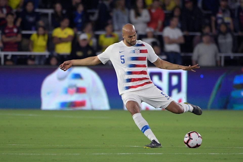 United States defender John Brooks (5) passes the ball during the first half of an international friendly soccer match against Ecuador Thursday, March 21, 2019, in Orlando, Fla. (AP Photo/Phelan M. Ebenhack)