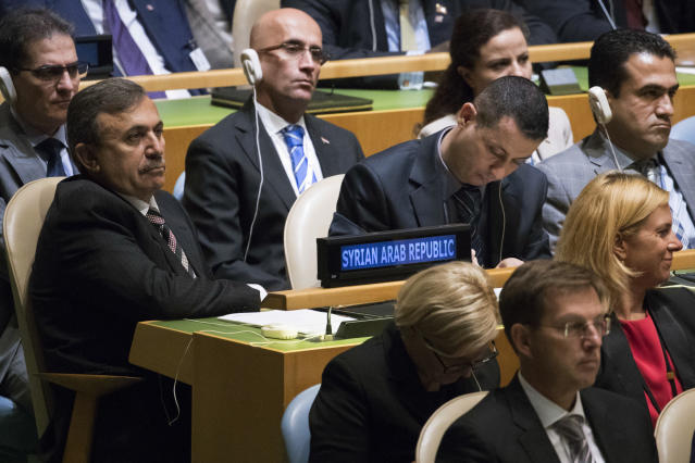 <p>Members of the Syrian delegation listen as President Trump speaks during the 72nd session of the United Nations General Assembly at U.N. headquarters, Tuesday, Sept. 19, 2017. (Photo: Mary Altaffer/AP) </p>