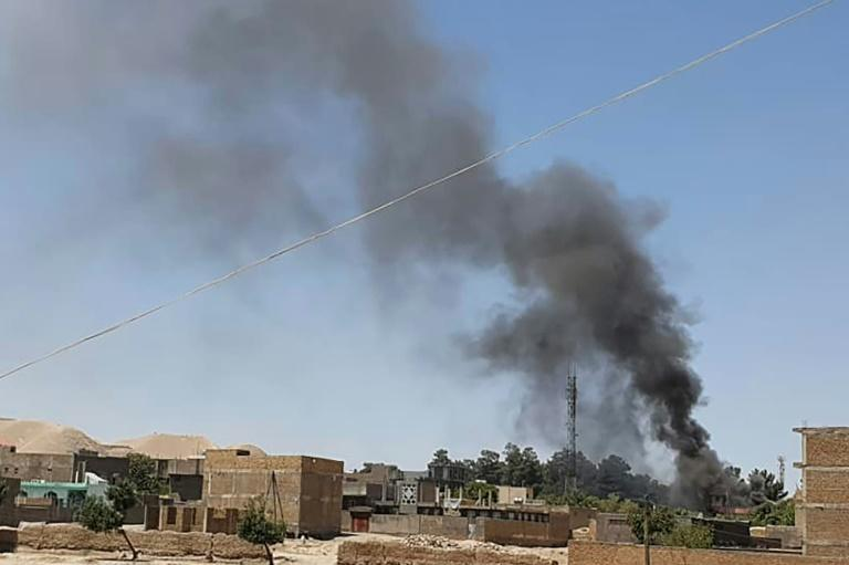 Smoke rises from houses amid the ongoing fight between Afghan security forces and Taliban fighters in the western city of Qala-i-Naw, the capital of Badghis province, on July 7, 2021