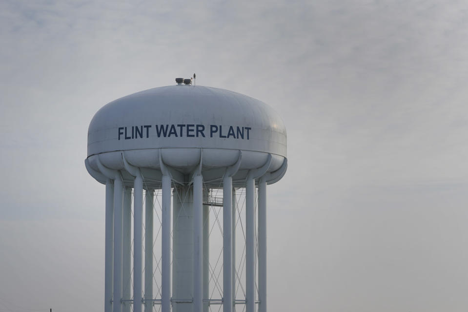 The Flint Water Plant tower is shown in Flint, Mich., Wednesday, Jan. 13, 2021. Some Flint residents impacted by months of lead-tainted water are looking past expected charges against former Gov. Rick Snyder and others in his administration to healing physical and emotional damages left by the crisis. (AP Photo/Paul Sancya)