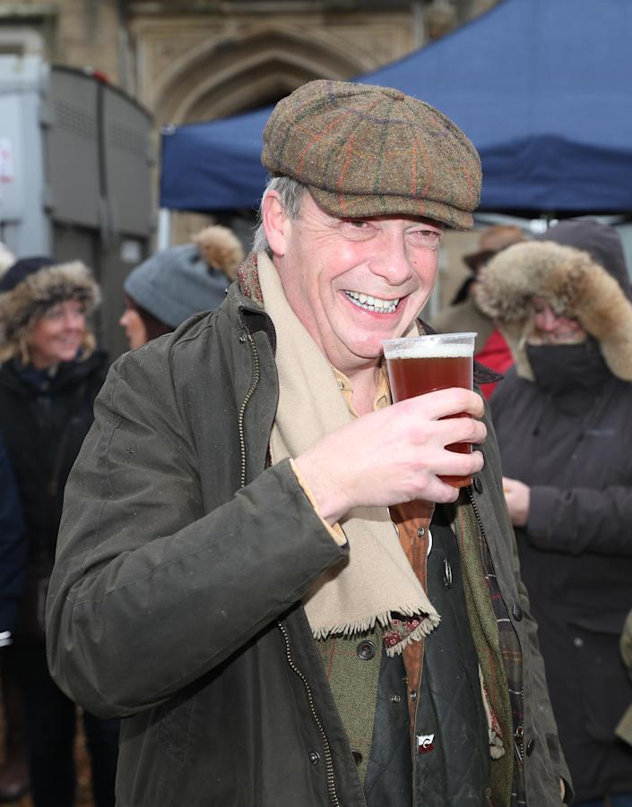 Nigel Farage enjoys a pint before the Old Surrey Burstow and West Kent Boxing Day Hunt in Edenbridge, Kent (PA)