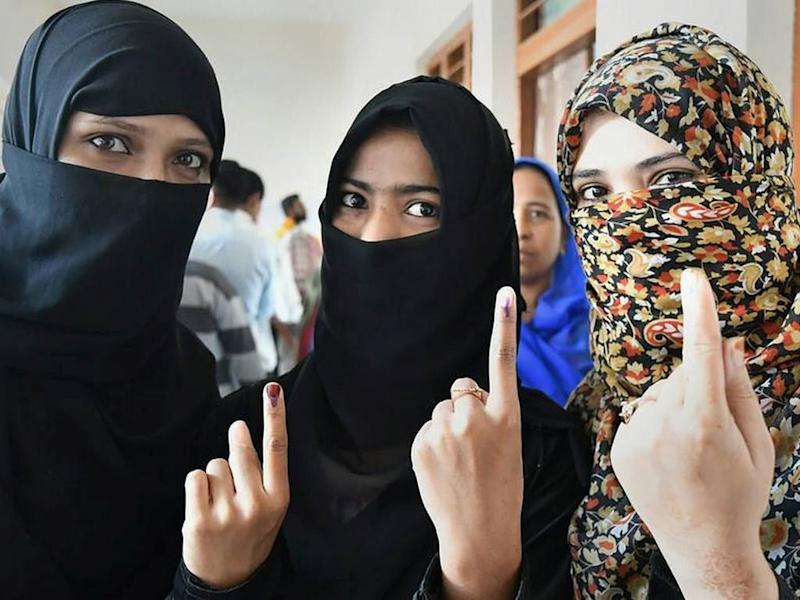 File photo of voters at a polling booth in Mahdya Pradesh. PTI
