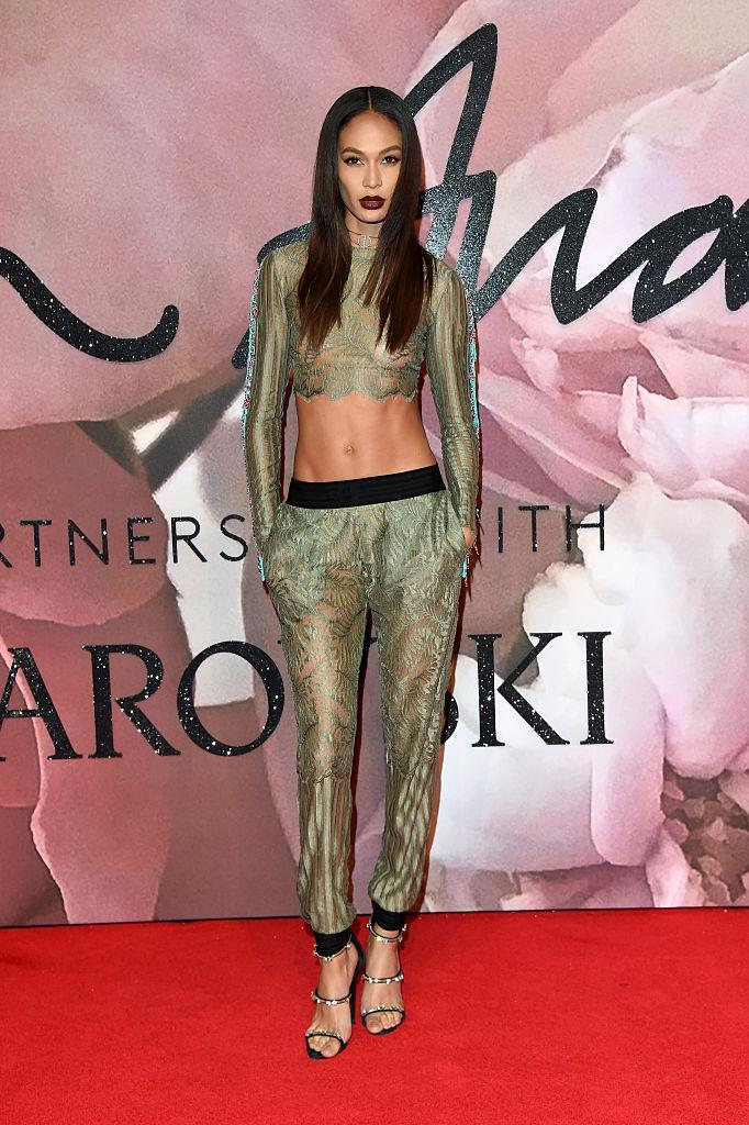 <p>Smalls displayed her enviable abs in a tight long-sleeved, green crop top with matching lace, sheer tapered pants. (Photo: Getty Images) </p>