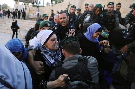 Palestinian demonstrator fights with Israeli security forces during a protest against U.S. embassy move to Jerusalem and ahead of the 70th anniversary of Nakba, near Damascus Gate in Jerusalem's Old City,