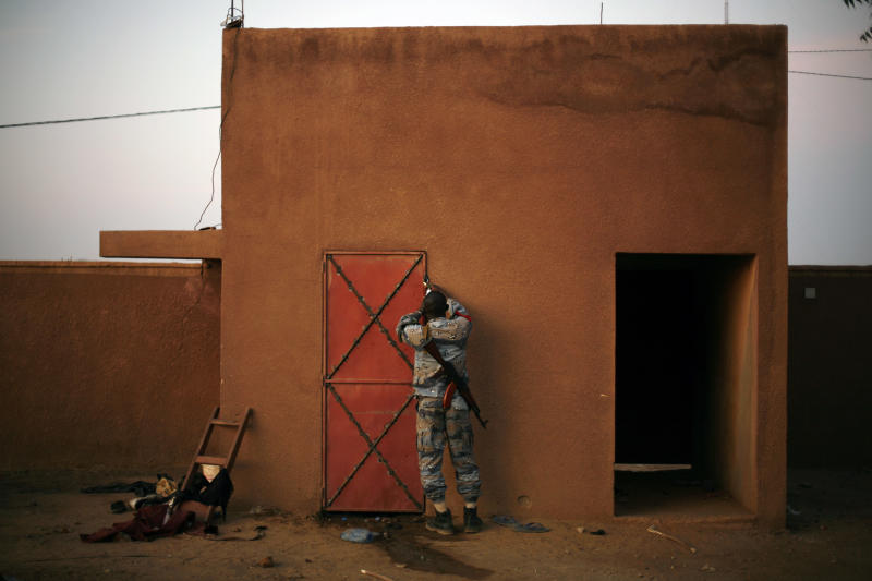 A Malian officer closes a cell where suspected Islamist rebel group the Movement for Oneness and Jihad in West Africa, MUJAO, fighters are held in Gao, northern Mali, Monday Feb. 11 2013, one day after MUJAO fighters engaged in a firefight with Malian forces.The attack in Gao shows the Islamic fighters, many of them well armed and with combat experience, are determined and daring and it foreshadows a protracted campaign by France and other nations to restore government control in this vast Saharan nation in northwest Africa.(AP Photo/Jerome Delay)