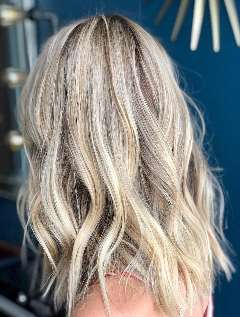 For a really rich, layered blond, have your stylist mix cool and warm tones like bright blond and honey. For this color, Grummel lightened her base and went in with full highlights to keep the color from looking flat.