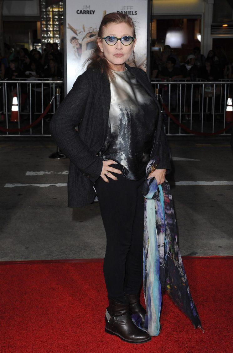 <p>Fisher arrives at the Los Angeles premiere of <em>Dumb And Dumber To</em> at Regency Village Theatre on Nov. 3, 2014, in Westwood, Calif. (Photo: Axelle/Bauer-Griffin/FilmMagic)</p>