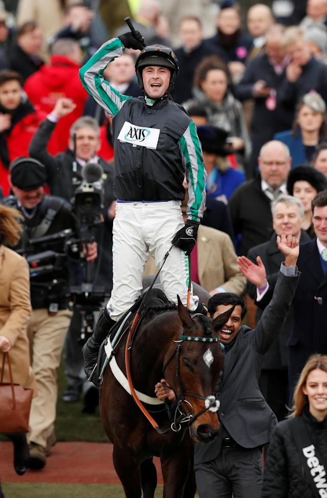 Horse Racing - Cheltenham Festival - Cheltenham Racecourse, Cheltenham, Britain - March 14, 2018 Nico de Boinville celebrates after riding Altior to victory in the 15:30 Betway Queen Mother Champion Chase Action Images via Reuters/Andrew Boyers