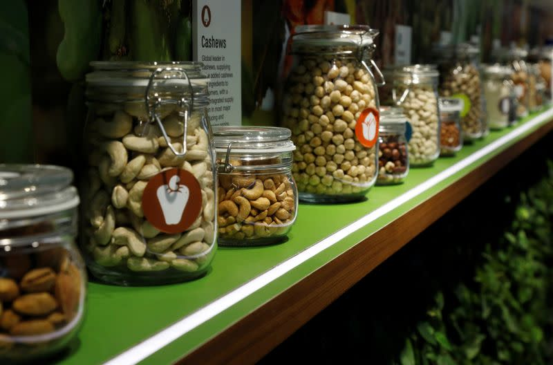 Jars of Olam's products, such as almonds, cashews and peanuts are displayed in their office in Singapore
