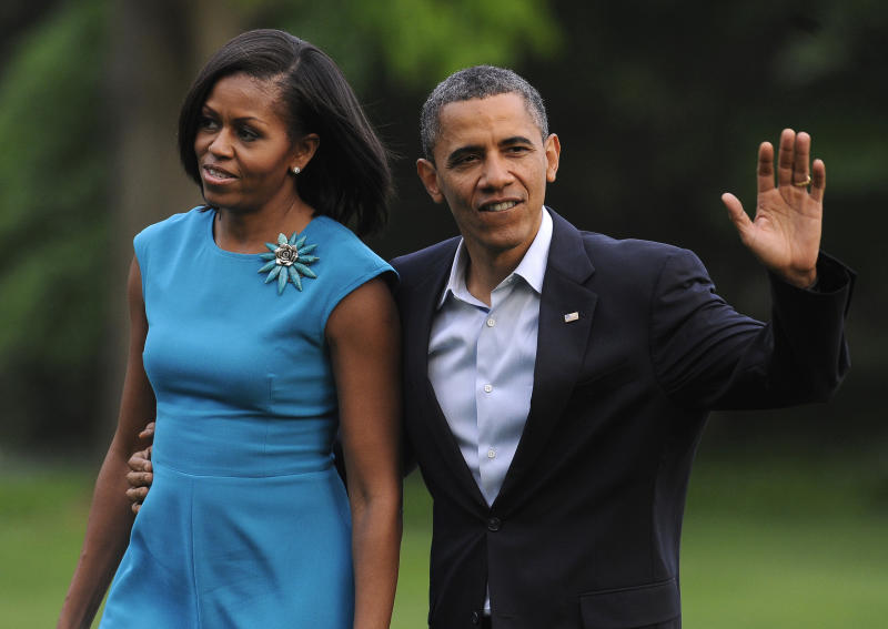 President Barack Obama and first lady Michelle Obama return to the White House, Saturday, May 5, 2012, in Washington. President Obama made campaign visits to Columbus, Ohio and Richmond, Va. during his first official day of campaigning for a second term. (AP Photo/Richard Lipski)