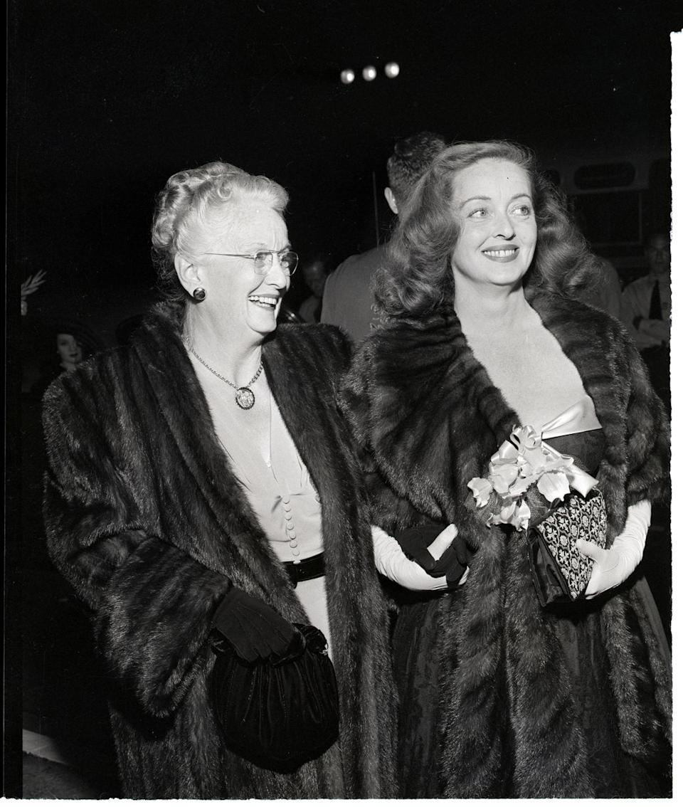 <p>Bette Davis and her mother, Ruth Davis Budd, arrive at the Hollywood premiere of <em>All About Eve</em> on November 17, 1950. The film, which is based on a true story, was originally titled <em>Best Performance</em>.</p>