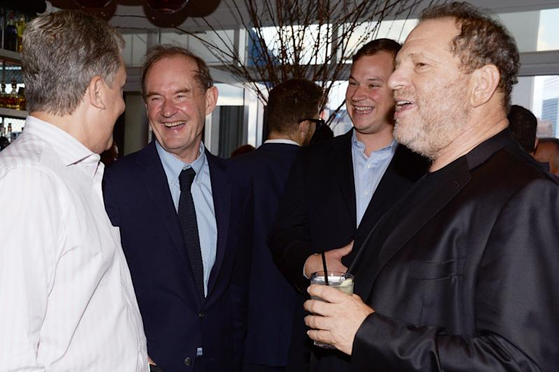 New York Times publisher Arthur Sulzberger, left, lawyer David Boies, a guest and studio executive Harvey Weinstein attend a cocktail party in New York City in 2014.
