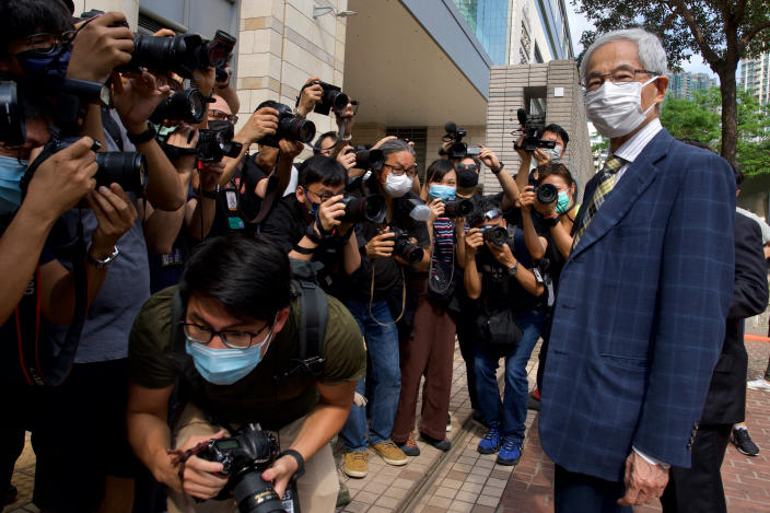 Pro-democracy lawmaker Martin Lee, right, arrives at a court in Hong Kong Thursday, April 1, 2021. Seven pro-democracy advocates, including media tycoon Jimmy Lai and veteran of the city's democracy movement Lee, are expected to be handed a verdict for organizing and participating in an illegal assembly during massive anti-government protests in 2019 as Hong Kong continues its crackdown on dissent. (AP Photo/Vincent Yu)