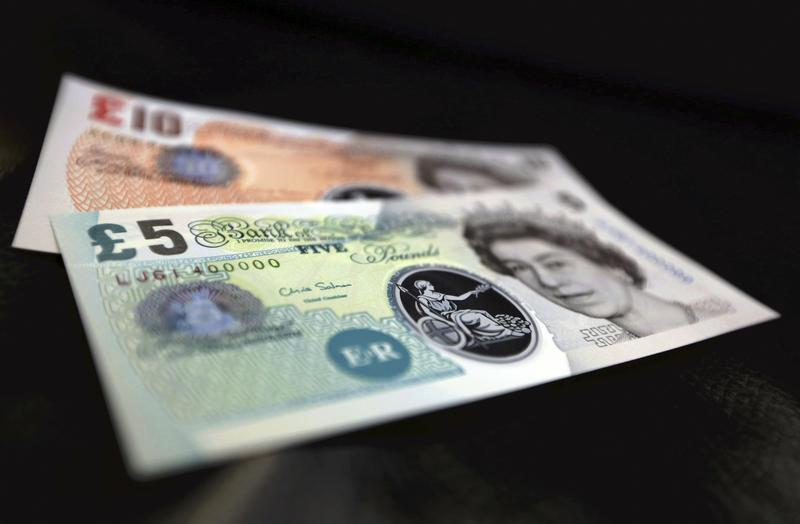 Sample polymer five and ten GB pound banknotes are seen on display at the Bank of England in London