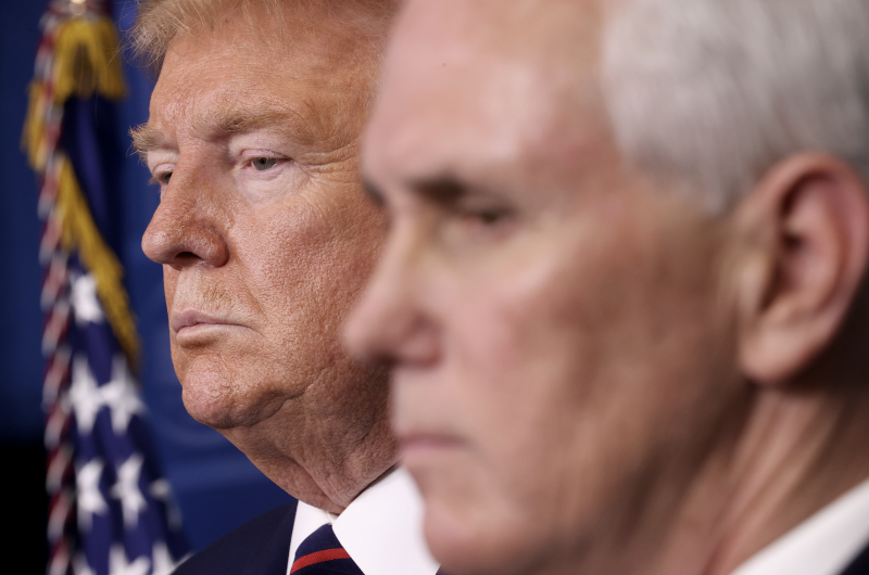 US President Donald Trump and US Vice President Mike Pence look on during the daily briefing on the novel coronavirus, COVID-19, in the Brady Briefing Room at the White House on April 2, 2020, in Washington, DC. (Photo: MANDEL NGAN/AFP via Getty Images)