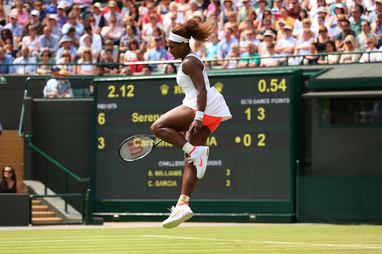 LONDON, ENGLAND - JUNE 27: Serena Williams of the United States of America leaps in the air as she celebrates a point during the Ladies' Singles second round match against Caroline Garcia of France on day four of the Wimbledon Lawn Tennis Championships at the All England Lawn Tennis and Croquet Club on June 27, 2013 in London, England. (Photo by Julian Finney/Getty Images)