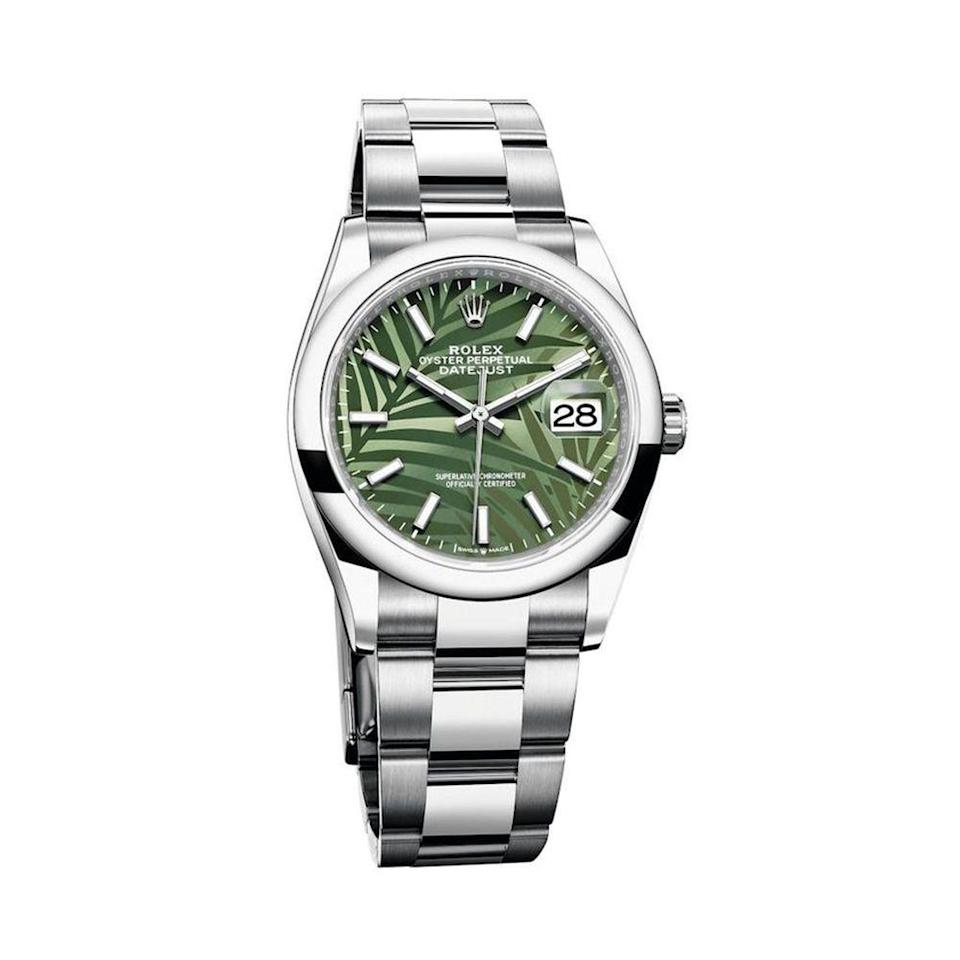 "<p><strong>Rolex</strong></p><p>rolex.com</p><p><strong>$7050.00</strong></p><p><a href=""https://www.rolex.com/watches/datejust/m126200-0020.html"" rel=""nofollow noopener"" target=""_blank"" data-ylk=""slk:Shop Now"" class=""link rapid-noclick-resp"">Shop Now</a></p><p>Rolex's chic and timeless Oyster Perpetual DateJust 36 gets a fun update with a palm motif dial. Inspired by tropical forests, this DateJust is the perfect piece to inspire a vacation state of mind.</p>"