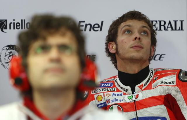 Ducati Team's Italian Valentino Rossi looks up inside the pit during the Moto GP Training session of the Valencia Grand Prix at Ricardo Tormo racetrack in Cheste, on November 9, 2012. AFP PHOTO/ JOSE JORDANJOSE JORDAN/AFP/Getty Images