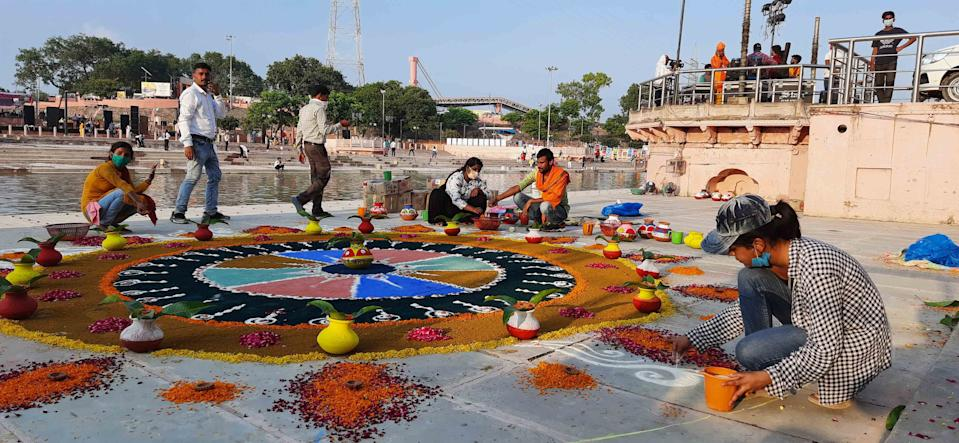AYODHYA, INDIA - AUGUST 4: Rangoli being made as part of decorations on the eve of the Ram Temple foundation laying ceremony on August 4, 2020 in Ayodhya, India. Prime Minister Narendra Modi will on Wednesday attend a public function on laying of the foundation stone of 'Shree Ram Janmabhoomi Mandir' at Ayodhya. Ram Janmabhoomi Teerth Kshetra, the trust set up for the construction and management of Ram temple, has invited 175 eminent guests for the foundation stone-laying ceremony after personally discussing with BJP veterans L K Advani and Murli Manohar Joshi, lawyer K Parasaran and other dignitaries. (Photo by Deepak Gupta/Hindustan Times via Getty Images)