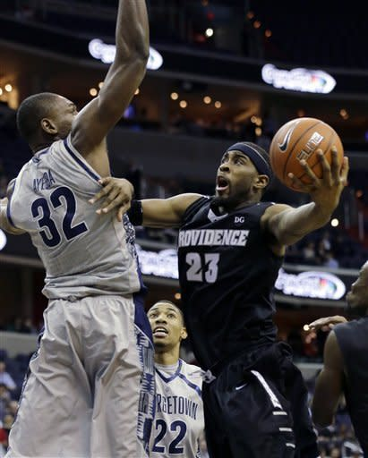 Providence forward LaDontae Henton (23) shoots against Georgetown center Moses Ayegba (32) during the first half of an NCAA college basketball game, Wednesday, Jan. 16, 2013, in Washington. (AP Photo/Alex Brandon)