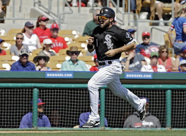 Chicago White Sox's Adam Eaton races home to score on a single by Jose Abreu in the first inning of a spring exhibition baseball game against the Texas Rangers Tuesday, March 11, 2014, in Glendale, Ariz. (AP Photo/Mark Duncan)