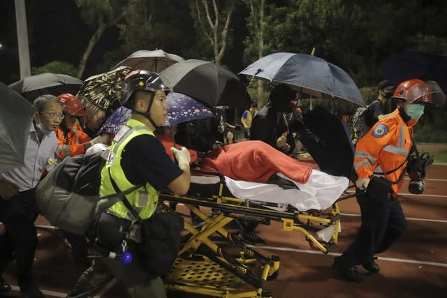 Medical workers move an injured student